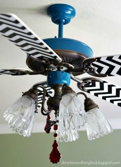 Update ceiling fans instead of buying new. Cute ideas (this chevron isn't my favorite but the method is good). The boy fan is awesome.Dimples and Tangles: Sassy Ceiling Fans Ceiling Fan Blade Covers, Ceiling Fan Blades, Painting Ceiling Fans, Apartment Therapy, Ceiling Fan Makeover, My New Room, E Design, Decoration, Home Projects