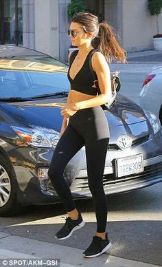 Dash just like the clothing: Kendall wore her hair in a low pony tail...