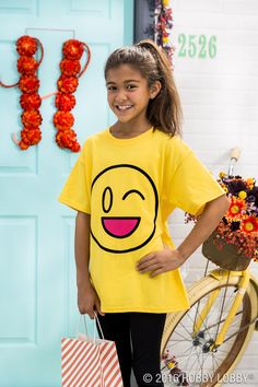 Create a trendy DIY costume that's simple and sure to score the best treats! Cut the pieces of an emoji design on black transfer sheet and apply to a yellow t-shirt. Using a pink transfer sheet, mount on the shape of a smile to complete the look!