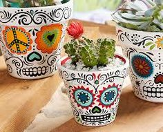 I'm going to try to make these sugar skull pots despite the fact that I can't draw worth a shit.