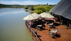 "Our ""African style"" A la Carte Restaurant - Game Lodge Accommodation Oudtshoorn Klein Karoo Western Cape Restaurant Game, Restaurant Offers, Game Lodge, Wooden Decks, Big Fish, Mauritius, Turtles, Wines, South Africa"