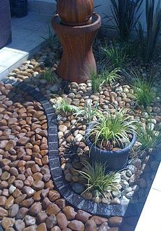 Attractive hardscaping with rocks of different colors and separating them with dark stone bricks.