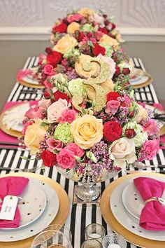 I love the bold colours of this event styling; black and white, hot pink and gold - no stripes.