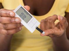 Woman taking blood glucose test