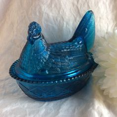 This is a cobalt blue nesting hen . It was made by Westmoreland in the 1920s, and carries the Westmoreland signature. The hen has a split tail and the bottom is a basket.