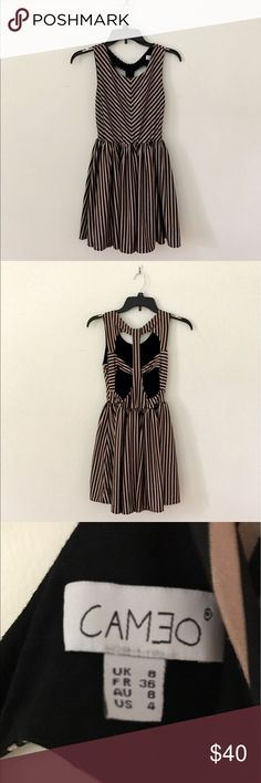 Gold and Black Striped Dress Super flattering dress with gold and black stripes and cutouts in the back. Made of a thick fabric and in excellent condition! ModCloth Dresses
