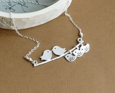 Our Three Baby Birds -- Mod Family Tree with Sterling Silver Chain -- Silver Necklace. $28.00, via Etsy.