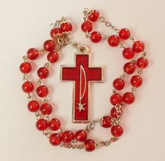 Anglican Prayer Beads Rosary (Episcopalian) -- Red glass beads with an enamel Chi-Rho cross. $18.00, via Etsy.