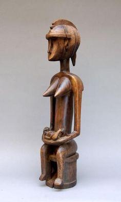 Malinke Mali Statue du Jo, le personnage est assis sur un trône cylindrique