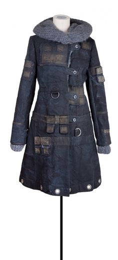 cool coat - looks like it's made from old sails or something