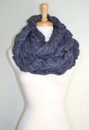 Sparkle in style and warmth with this knitted infinity loop scarf.  Adorned with a silver thread, perfect for adding the right amount of glam to your outfits. $32.99 Use code PINIT at checkout for 10% off your entire order.