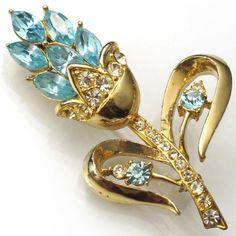 Coro-SIGNED-blue-rhinestone-flower-brooch-c-1940s