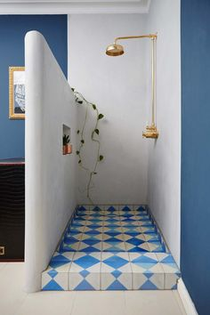 Bert and May tiles in the shower tray - a shot of holiday colour that works beautifully with brass. Add a trailing plant.