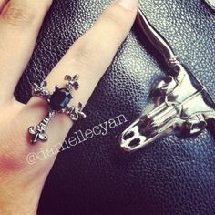HPedgy gunmetal cross ring comes with pouch Edgy gunmetal cross ring with stone. Adjustable. Jewelry Rings