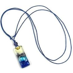 Sand and Sea Fused Glass Pendant Necklace - Tili Glass - Handcrafted in Chile, this necklace celebrates the colorful art of fused glass. The cord adjusts from 16 to 32 inches, and the pendant measures 1.25 inches long.