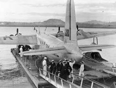 """Passengers and crew disembarking from Tasman Empire Airways Limited's Sandringham Flying Boat ZK-AME 'RMA New Zealand' at Mechanics Bay, Auckland,"""" c.1947"""