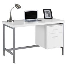 $290 Sleek and contemporary, this white finished desk is the perfect combination of function, durability and design in a modern form. With clean lines, a large, thick paneled surface and stylish silver metal legs, this piece will add pizzazz to any home office. Featuring a large storage drawer and a file drawer accented by silver colored drawer pulls to help keep your office supplies and documents organized and desktop clutter free. This desk provides plenty of room to meet your working…
