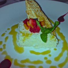 Coconut soufflé, toasted coconut, mixed berries, orange pineapple ...