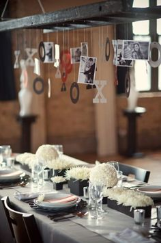 I would love to do this with longer strings of pictures hanging from the ceiling- love this idea for intimate parties, mother days brunch, Father's Day & u c's mix it with kids art work! :) love love love!