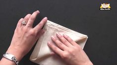 The Art of Napkin Folding. I find that this video tutorial has all your needs for napkin folding