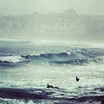 Surfers on a stormy #Bondi Beach, #Sydney, #NSW, #Australia. Image by @lunarsynthesis. #lonelyplanet #travel