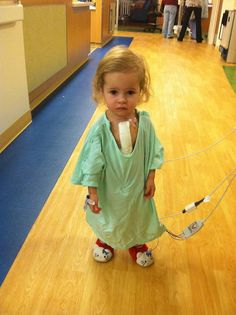 This beautiful little girl had open heart surgery less than 24 hours before this photo was taken. When asked why she was up so quickly, she replied her Hello Kitty slippers make everything better.