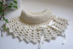 Knitted collar with crocheted trim. Interesting . . .