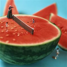 Tiny people play around on food in surreal photos