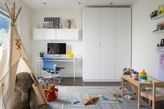 Design Ideas: Office Room Integrated With Kids Playroom. playroom ideas. office room. elephant doll. wooden table. wooden chair. white closet. blue office chair.