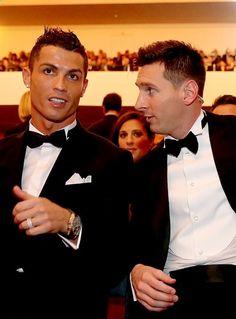 FIFA Ballon dOr nominee Cristiano Ronaldo of Portugal and Real Madrid sits with FIFA Ballon dOr nominee Lionel Messi of Argentina and Barcelona during the FIFA Ballon dOr Gala