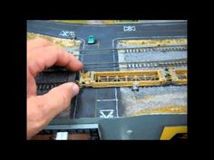 Lets learn to re-rail the N Scale Kato Maxi-1 Car by Fifer Hobby Supply