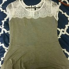 Gray peplum blouse with white lace Beautiful gray peplum top with white lace on top. Very soft fabric. Used but in great condition. No flaws. Back has a visible zipper. Figure flattering. Kensie Tops Blouses