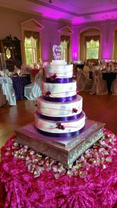 Smooth buttercream finish, colored glitter dust, ribbons and fresh floral accents. Glitter Dust, Specialty Cakes, Wisteria, Got Married, Four Square, Ribbons, Wedding Cakes, Smooth, Fresh