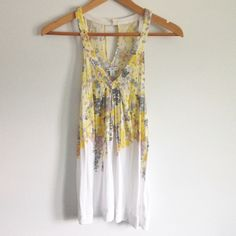 """White & Yellow Floral Tank Top Soft, relaxed fit tank top with a romantic floral print. Key-hole opening at the back with a button closure. American Eagle, size small. Measures 27"""" long, 17"""" wide. 100% rayon. Great condition! American Eagle Outfitters Tops Tank Tops"""