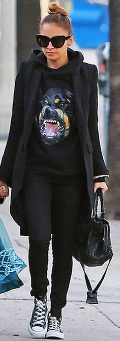 Who made  Nicole Richie's black sunglasses, black skinny jeans, black sneakers, and dog print sweatshirt?