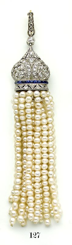 Natural pearl, diamond, calibré sapphire, gold and platinum tassel pendant.