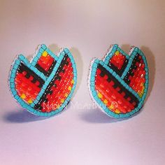 Cute little custom quarter sized mini tulips, in turquoise and fire colors by…