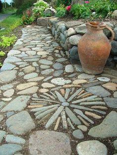 Stone Mosaic for Garden Walkway. JORGE again random patterns along path and verandah