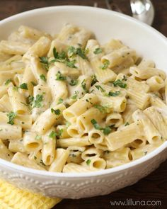 Super simple and delicious Creamy Garlic Penne Pasta recipe on { lilluna.com } Packed with flavor, this dish is perfect by itself or you can add chicken for a more hearty meal.