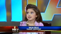 Strange pageant kid enjoys herself in the camera...funny