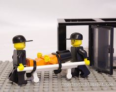 """By: Legofesto / LEGO recreation of the transport and imprisonment of """"enemy combatants"""" at Guantanamo Bay. / c. 2007"""