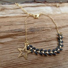 Bracelet chaîne dorée et chaîne émaillée noire