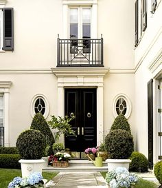 The Exquisite Home.  love the railing at the window --  plants in urns......