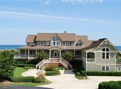 FOUR SEASONS RETREAT, Cottage #601.  Outer Banks vacation rental, prime oceanfront location in the town of Duck. Reserve at www.CarolinaDesigns.com.