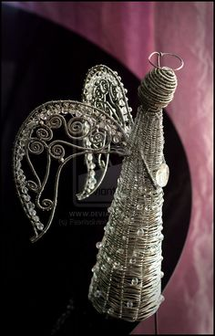 wire wrapped angel sculpture. tree topper inspiration.