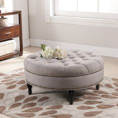 @Overstock.com - Palfrey Beige Linen Modern Tufted Ottoman - This stunning modern ottoman is made with durable eucalyptus wood for its frame, firm foam cushioning, and beige linen upholstery. Antiqued brass upholstery tacks line the sides.   http://www.overstock.com/Home-Garden/Palfrey-Beige-Linen-Modern-Tufted-Ottoman/8463078/product.html?CID=214117 CAD              364.20