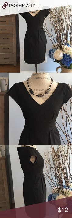"""H&M little black dress size 4. Cotton stunning black dress with long invisible zipper. Won't fit fully closed on my mannequin. Size 4. Short cap sleeves. Worn a few times but still in very good condition. Length is 33 1/2 and bust is 15"""". Waist is 13 1.2 H&M Dresses Midi"""