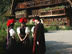 "Black Forest tradtional garb. The ladies hat is called a ""Bollenhut."""