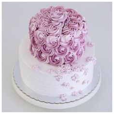 Two tiered 2D rosette and hydrangea buttercream cake                                                                                                                                                       More