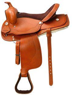 Silla Western Randol's 'Wichita'. Silla Western fabricada en cuero de búfalo. Armadura de fibra tipo Rooper. Asiento y bastes muy acolchados forrados de borreguillo sintético que mejora la comodidad tanto del caballo como del jinete.  Color: Avellana Talla única 16''